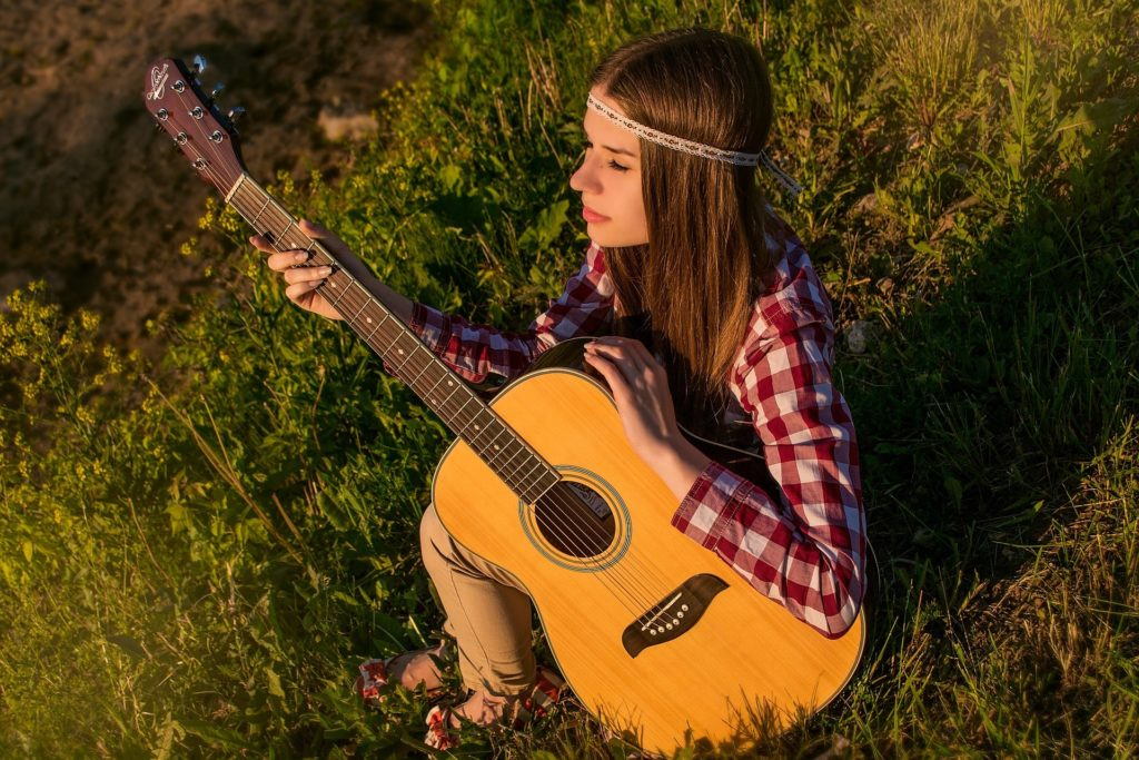 girl with guitar - Rebel Retirement