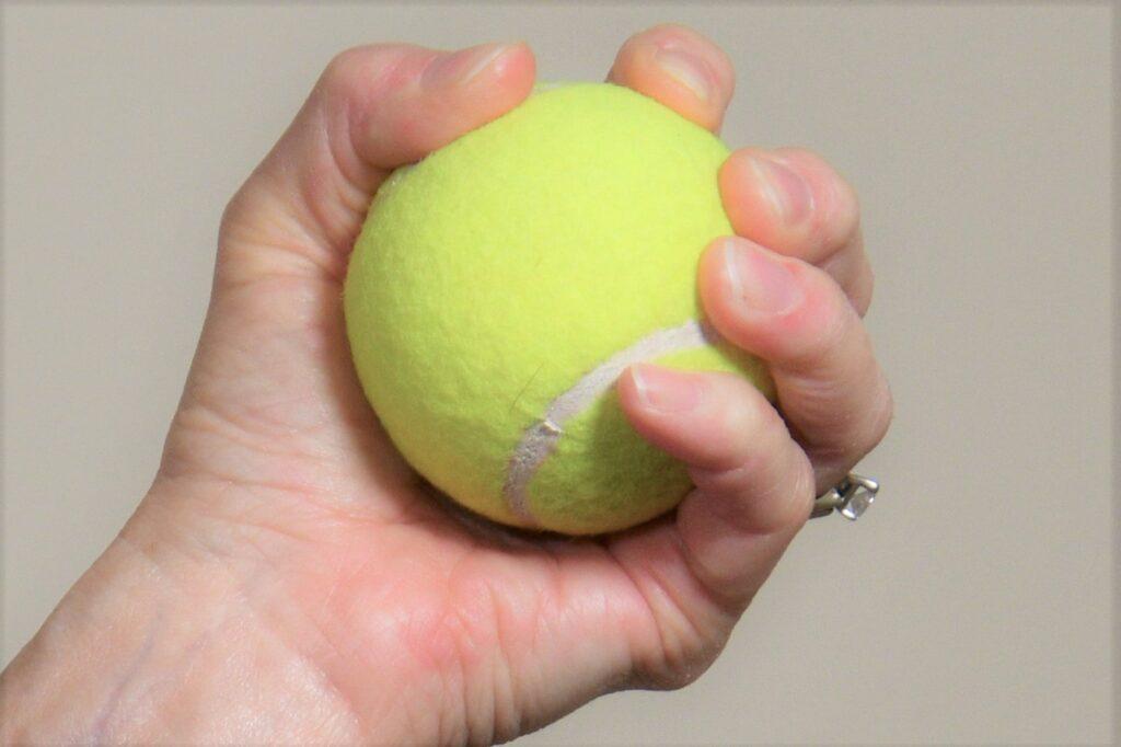 Tennis ball hand strength exercise - Rebel Retirement